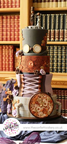Steampunk wedding cake, complete with top hat and flying goggles, corset, cogs and gears. Venue: Stoke Rochford Hall. Cake & Image: The Confetti Cakery.