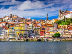 PORTO, PORTUGAL looks like a dream, with its colorful architecture, medieval ruins, stunning churches, and glimmering bell towers. As the origin of port wine, Porto has many riverside wine dwellings and cellars, in addition to a growing number of music venues.