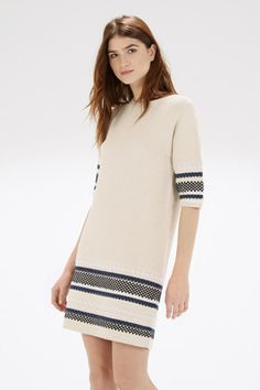 This chunky stitch jumper dress is constructed from a mid-weight knit with stretch and features a round neck, 3/4 length sleeves and a striped stitch design. Height of model shown: 5ft 10 inches/178cm. Model wears: UK size 10.