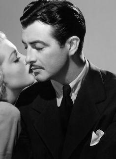 Robert Taylor (and I think that's Lana Turner kissing him)