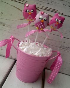 Owl cake pops and matching cupcakes for a baby shower: