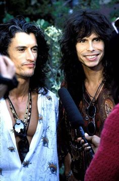 Steven Tyler and Joe Perry. Good lawd Steven is so beautiful when he smiles. And all the time... But, especially when he smiles.