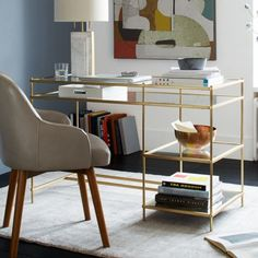 Terrace Desk. West Elm. Top brass. The Terrace Desk's antique brass finish gives it a pretty patina, while tiered clear glass shelves appear to float above a mirrored glass base.