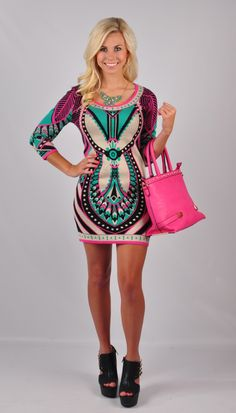 Set your sights on our Pattern Dress! This fun and colorful dress is perfect for a day out on the town! Whether shopping on Fifth Avenue or heading out to lunch with the girls, this dress is easy and fun to wear! Get this dress online at www.VirgoBoutique.com!