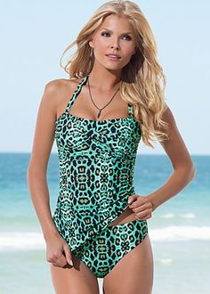 Mint Animal (MTA) Twist Bandeau Tankini Top $42 Hidden cups shape your bust and sexy gathers hide a multitude of sins! ·  Sizes 4 - 14   ·  Full back and longer overall length for comfort   ·  Detachable neck strap  ·  Style #V1392 MTA Domestic or import of quality nylon/spandex tricot
