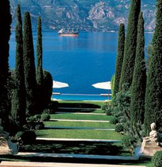 An allée of cypress trees sloping down a hill towards water's edge at Villa Fiorentina was the work of renowned British landscaper Russell Page.