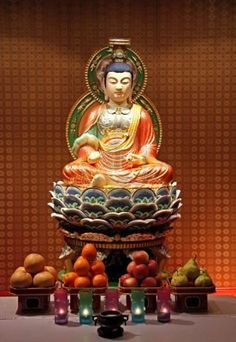 Buddha Statue in Chinese Temple with Offerings.