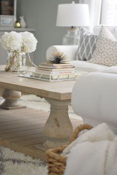 A beautiful wood coffee table complements a neutral living room