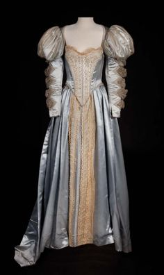"""Olivia de Havilland """"Lady Penelope Gray"""" silver satin period gown from The Private Lives of Elizabeth and Essex., designed by Orry-Kelly (Debbie Reynold's Collection) Tudor Dress, Vintage Outfits, Vintage Fashion, Vintage Clothing, Vintage Dresses, Hollywood Costume, Hollywood Dress, Olivia De Havilland, Renaissance Fashion"""