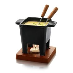 Fondue sets to enjoy melted cheese or chocolate in a communal pot with long stem dipping forks. The Tapas Fondue set requires tea lights and the Nero style requires flammable gel. Small Tapas Raclette set folds up for compact storage and is powered by thr Chocolate Dipped, Chocolate Fondue, Chocolate Cheese, Queso Edam, Chicharrones, Fondue Recipes, Fondue Ideas, Cheese Lover, Cheese Tasting