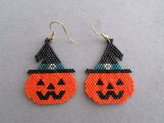 Jack-O-Lantern Earrings in delica seed beads by DsBeadedCrochetedEtc on Etsy https://www.etsy.com/listing/240684776/jack-o-lantern-earrings-in-delica-seed