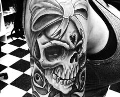 Love this skull tattoo.