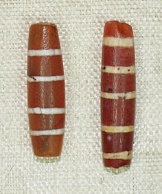 Ancient etched striped carnelian beads originally found in Tello, ancient Girsu (the Indus Valley ) | ca 3000 BC. The stripes are created by painting the carnelian with a mixture of potash and white lead and then fired. During the time of their manufacture there existed an ancient maritime trade network between ancient Mesopotamian and Harappan cultures
