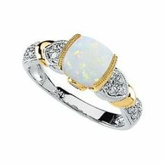 14k opal, tanzanite and diamond ring Call or email for information and availability ddjewelry@gmail.com  (425)827-7722