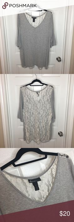Lane Bryant gray blouse with white lace back Lane Bryant gray shirt with white lace back. Same style as the green blouse pictured. Lane Bryant Tops Blouses