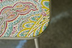 Card table makeover - use a vinyl tablecloth to recover an old card table