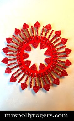 Click here to DIY Queen of Hearts Dollar Tree Valentine Wreath.  Fast, cheap & easy!!  Blog & Photos from MrsPollyRogers.com