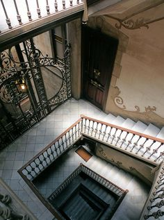 Barcelona stairwell with gorgeous ironwork & trompe l'oeil...