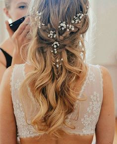Loving the hair style that oozes a simple yet elegant look. Incorporating baby's breath as accessory, this hairstyle is the ultimate look for a sweet touch. Mixture of braid and curls for wedding hairstyle