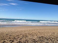 Wainui Beach, Gisborne. Perfect A frame peaks.