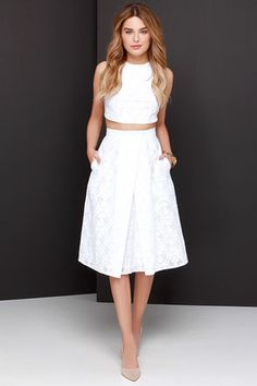 "You can relax knowing you're rockin' an on-point ensemble with the Piece and Harmony Ivory Two-Piece Dress! This puckered woven crop top with a tantalizing texture, and darted accents, is complemented by stretchy elastic trim that meets at a sliding, shiny gold closure at back. The matching midi-length skirt adds a classic touch with its banded waist, and asymmetrical box pleats. Skirt has hidden back zipper. Fully lined in stretch knit. Small top measures 13.5"" long. Small bottom measures…"