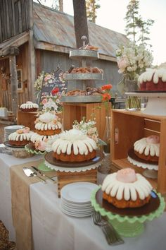 bundt cake table, photo by Emily Heizer http://ruffledblog.com/woodsy-sierra-nevada-wedding #desserts #wedding #cakes
