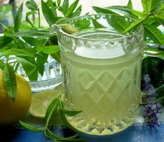 Pull up a hammock, select a good book and make a jug of this cooling lemonade to refresh you as you gently sway and wile away the long, hot hours! A simple zingy lemonade syrup that is added to water to dilute and is compulsory for hot, humid days! Lemon Verbena is one of my favourite herbs and is a welcome addition to my walled herb garden here in France. The syrup is also amazing if poured over ice creams and summer berries for a tangy citrus flavour. Add an attractive label and a sprig…