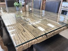One of our rustic, handcrafted & reclaimed wood dining tables (protected by generously thick glass)