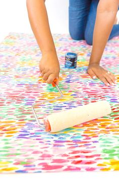 Large area rugs can be pricey! Follow this tutorial on how to turn a regular piece of fabric into a DIY Mod Podge Fabric Rug. It's totally customizable and afforable.