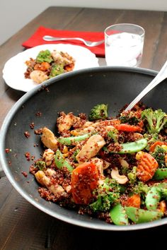Cashew Chicken Quinoa Stir Fry | I promise that this is a healthy meal that is way more fun than salad. This stir fry combines tender chicken with carrots, steamed broccoli, crunchy snow peas, cashews, and quinoa with a sweet and salty sauce. I kept my stir fry on the mild side, but you can easily spice things up by adding more sriracha. @thekittchen