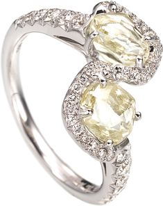 Champagne Bubbles bypass ring featuring 2.20cts of rough diamonds accented with 0.52cts of micro pavé diamonds in 18k white gold. wow :}}