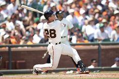 SAN FRANCISCO, CA - JULY 13: Buster Posey #28 of the San Francisco Giants hits a grand slam home run off of Vidal Nuno (not pictured) of the Arizona Diamondbacks during the fifth inning at AT&T Park on July 13, 2014 in San Francisco, California. (Photo by Jason O. Watson/Getty Images)