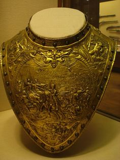 Gilt brass gorget. Most likely Dutch, c. 1630. The scenes of battle are engraved after Italian painter Antonio Temptesta and Baroque printmaker Jacques Callot. In the collection of the Metropolitan Museum of Art.