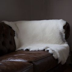 Purchase top deals in #SheepskinThrows available in white color.