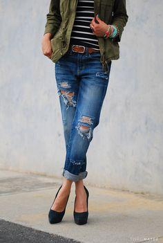Ripped boyfriend jeans, black striped top, a pair of black velvet closed toe pumps and a casual jacket to top off the look.