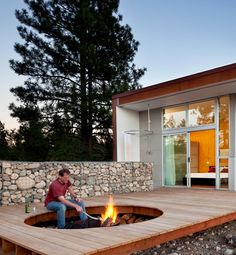 cutout in the decking creates an instant attraction in the rocky landscape with built-in seating