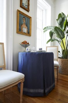 A blue skirted table serves as the main dining space, which could be pulled out from the wall to accommodate more.