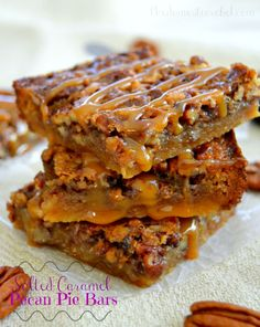 These Salted Caramel Pecan Pie Bars are perfection and great for Thanksgiving and Christmas feasts! Easy to make, youll never guess the secret surprise crust and how DELICIOUS they taste!