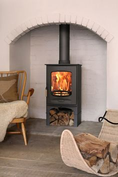 Wood burning, multi-fuel & gas stoves Glasgow at Stove World Glasgow. We stock Charnwood & Contura stoves with live displays in our Glasgow stove showroom. Wood, Brick Fireplace Wall, White Brick, Home, Stove Black, Wood Burner, Wood Fuel, Wood Burning Fireplace, White Wood