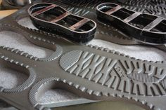 Prep Room: Our sole is made of an EVA rubber composition and is delivered to us from a factory in Italy in sheets of 10 pairs, smooth on one side with the tread on the reverse. This allows us to cut the sole in our factory into the desired size and enables us to react to customer demand and special orders. Just like the cutting stage, we use metal knives and the hydraulic press to stamp out the size of sole that we need for the specific batch of footwear. Men's Shoes, Shoe Boots, Shoes Sneakers, Platform Sneakers, Leather Working, Metal Working, Sneakers Sketch, Sheepskin Boots, Slipper Boots