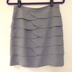 NWOT Gianna Bini grey tulip layer business skirt NWOT. Great condition. Fully lined with zipper. Perfect for a special occasion or professional attire. Gianni Bini Skirts