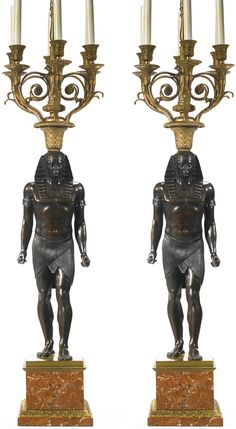 date unspecified A pair of Egyptomania gilt and patinated bronze six light candelabra France, late century Estimate — USD LOT SOLD. Antique Lamps, Antique Furniture, Ancient World History, French Empire, Light Fittings, Oil Lamps, Candlesticks, Candle Sconces, Egyptian