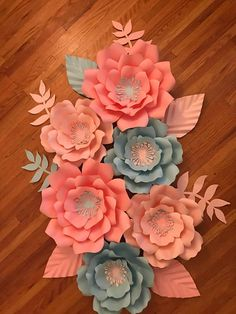 The Flower are handmade Great for wedding, parties, nurseries, wall art and special even decor. This is a set of 6 paper flowers of different sizes. Set include 2 Large Flowers 17-18 inches 4 Medium Flowers 13-15 inches Plus 8 leaves CENTERS gold, silver or any color choices