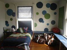 A Nest for All Seasons :: painted circles of several colors & of various sizes are scattered on an accent wall...