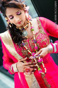 Pink Indian bridal outfit and makeup with floral jewelry by tAnirika via IndianWeddingSite.com