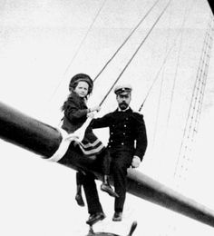 grand duchess tatiana and her father tsar nicholas II sit in the rigging of the polar star