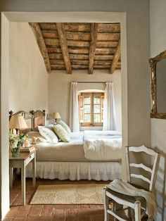 bedroom with rustic ceiling