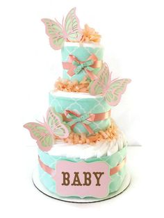 This stylish Mint Jubilee Diaper Cake is constructed with 3 layers of brand name disposable diapers, quality matching ribbons and bows and adorable handcrafted 3D butterfly card stock cutouts! Description from etsy.com. I searched for this on bing.com/images