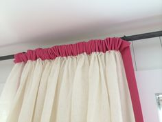 Pleated header in pink accent (guest bedroom curtain heading)