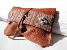 Leather clutch with vintage fabric